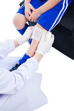 Youth asian sport boy in blue uniform. Knee joint pain. Youth asian (thai) sport boy in blue uniform. Knee joint pain. Doctor perform first aid at knee trauma royalty free stock photography