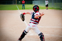 Youth baseball catcher throwing to second base. Royalty Free Stock Photography