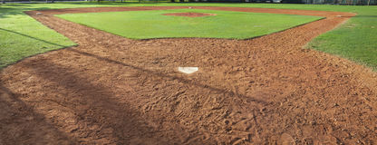 Youth baseball field viewed from behind home plate. A youth baseball field viewed from behind home plate in morning light Stock Photo