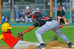 Youth Baseball out at 3rd royalty free stock photography