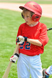 Youth batter on deck Royalty Free Stock Image