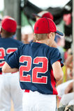 Youth baseball player in the dugout Royalty Free Stock Images
