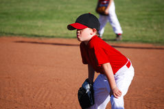 Youth baseball player hands on knees Royalty Free Stock Photo
