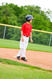 Youth baseball player on third base Stock Photos