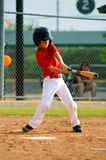 Youth baseball player swinging bat Royalty Free Stock Photos
