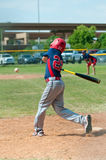 Youth baseball player swinging bat Royalty Free Stock Photography