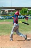 Youth baseball player swinging bat Royalty Free Stock Photography