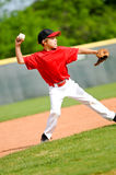 Youth ball player throwing ball Royalty Free Stock Photos
