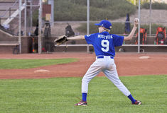 A Youth Baseball Player Throws the Ball Stock Images