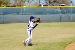 Youth shortstop about to throw ball Royalty Free Stock Images