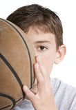 Youth with Basketball. Partially hidden behind face royalty free stock photography