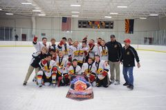 Youth Boys Hockey Tournament. Youth Hockey team celebrating their victory in a hockey tournament Stock Photo
