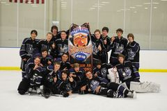 Youth Boys Hockey Tournament. Youth Hockey team celebrating their victory in a hockey tournament Stock Photography