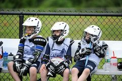 Youth Boys Lacrosse Tournament. Boys Lacrosse game in a tournament in New Jersey with teammates on the bench Stock Photos