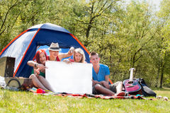 Youth on a camping with an empty sign board Royalty Free Stock Photos