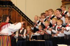 Youth choir festival. KAPOSVAR, HUNGARY - AUGUST 26: Members of the Suae Music School Choir (EST) sing at the IV. Pannonia Cantat Youth Choir Festival August 26 Royalty Free Stock Photos