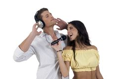 Youth couple enjoying music Royalty Free Stock Photo