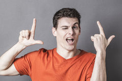 Youth culture concept for young man winking with LOL sign Stock Image