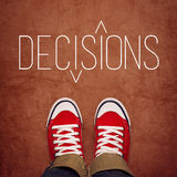 Youth Decision Making Concept, Top View. Youth Decision Making Concept, Feet in Red Sneakers from Above Standing at Ground with Decisons Title Printed, Top View Stock Photo