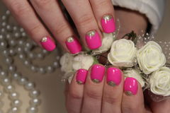 Youth design of manicure in pink color stock images
