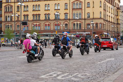 Youth driving moto scooters in the city of Tampere. Young men driving scooters on the streets of city Tampere Finland Stock Images