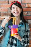 Youth eating habit female chinese noodles yummy. Youth eating habit. Takeout food. Excited female millennial with Chinese noodles. Yummy spicy meal, unhealthy stock photos