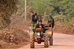 Youth farmers coming home by their farm vehicle one road Stock Photos