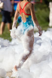 Youth at a foamy party on the beach Stock Images