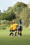 Youth Football. Young footballers playing in a match stock photography