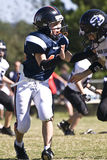 Youth Football Player Blocking Royalty Free Stock Photos