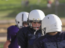 Youth football player concentrating on the play
