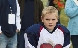Youth football player after the game Stock Photos