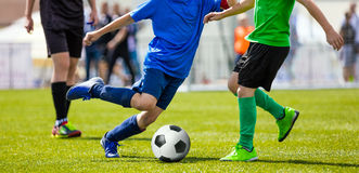 Youth Football Teams Playing Match on Sports Field. Young Boys Kicking Match Royalty Free Stock Image