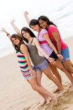 Youth friends. Group of youth teen girls friends on beach Royalty Free Stock Photo
