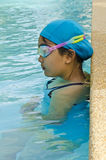 Youth girl swimmer. Girl with goggles in the swimming pool Stock Photo