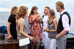 Youth group of eight people standing together Stock Photos