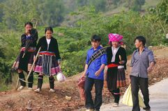 Youth group of ethnic flowered Hmong. This group of young boys and girls are back in the fields. We see that young men have unfortunately dropped their suits Royalty Free Stock Photography