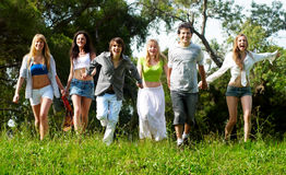 Youth group running on a grass stock photos