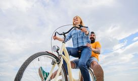 Youth have fun riding bike sky background. Enjoy summer holidays vacation riding bike. Couple in love happy cheerful. Enjoy cycling together. Happy moments royalty free stock photography