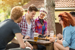 Youth having fun playing chess in wood Royalty Free Stock Photo