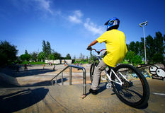 Youth on his bicycle. Male youth about to ride down the skate ramp on his bicycle Royalty Free Stock Photo