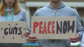 Youth holding slogans for world peace, against nuclear weapon, stop terrorism. Stock footage stock video