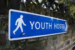 Youth Hostel Sign. Youth Hostel arrow sign on brick wall at Kensington area (London , Uk royalty free stock images