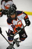Youth Ice Hockey. Arizona youth ice hockey league with both girls and boys play in game action located in Gilbert Arizona in the Southwest part of the United stock image