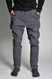 Youth jeans put on the guy. On a guy wearing jeans; view of the waist; guy in the jeans and socks Royalty Free Stock Images