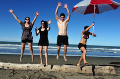 Youth Jumps to the Air on the Beach Stock Images
