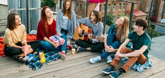 Youth leisure carefree sing relax alternative view. Youth leisure. Carefree young people sing songs play guitar and relax. Alternative subculture, unconventional Royalty Free Stock Photo