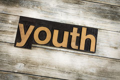 Youth Letterpress Word on Wooden Background Stock Photos