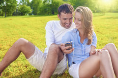 Youth Lifestyle Concept: Laughing Caucasian Couple Sitting Toget Stock Photos