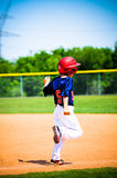 Baseball player running bases. Youth little league player running bases Stock Photos
